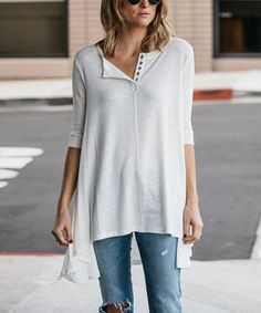 This laid-back tunic dress drapes casually from its button-front neckline to a breezy hi-low hem to offer carefree style to your daily look.