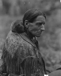 Baby beaver on ''Grey Owl's'' shoulder, Canada, 1931 - born in the UK, he took the name Grey Owl and the persona of an American Indian and the backwoods life style. He was a British fantasist.