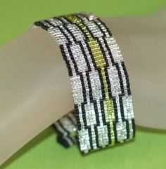 Staccato...  Super sparkly silver, lime green, and black peyote bracelet with a funky geometric pattern.  Fun!  $ 40