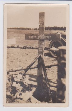"Vintage postcard : shows the cross that was erected at the crash site and original grave in France of Theodore Roosevelt's youngest son killed in a plane crash in WWI. ""Here lies on the Field of Honor, 1st Lt. Quentin Roosevelt, Air Service, USA, killed in action July 1918."