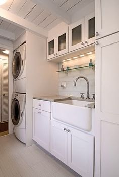 Stackable washer/dryer and cabinets