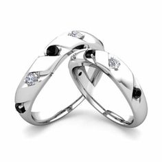 Unique matching wedding rings showcase round cut diamonds set in gold curved ring bands. His and hers wedding bands are matched perfectly for celebrating love as a marriage ring set. His And Her Wedding Rings, His And Hers Rings, Matching Wedding Rings, Wedding Band Sets, Black Diamond Wedding Rings, Diamond Anniversary Rings, Gold Band Ring, Diamond Engagement Rings, Anniversary Bands