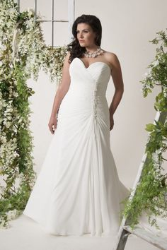 Soft rouching in delegate chiffon in a flattering A line silhouette. Embellished with freshwater pearls hand beaded down the bodice for a unique bodice.