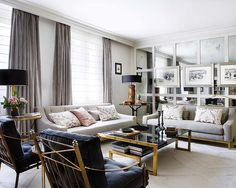 Living room by Pepe Leal... love the mirror