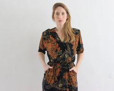 ON SALE  was 48$ now 38$!    1980s midi dress in black, with flowers and paisley pattern in shades of brown.  with warped and buttoned