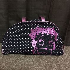 SALE! Medium Size Betty Boop Bag! Has been used. Slight wear & tear on handles, nothing major. Inside has three pockets, 1 zip up pocket and an area to store cards. Inside of zip up pocket has a few white stain marks. Bottom of inside has very limited white staining. Still a great bag! No trades Bags Satchels