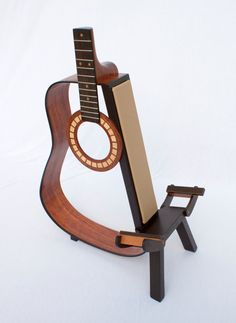 Looking for woodworking project inspiration? Check out Acoustic Guitar Stand by member Benjamin Lester. - via Craftsy Guitar Crafts, Guitar Diy, Acoustic Guitar, Wooden Guitar Stand, Guitar Wall Hanger, Guitar Hooks, Piano, Custom Electric Guitars, Music Stand