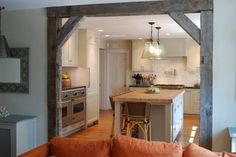 reclaimed barnwood to frame a separation between the kitchen and dining area
