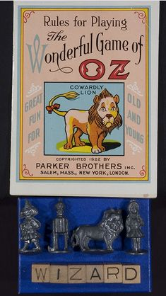 Oh my just look at the adorable game pieces!  Rule booklet and playing pieces for The Wonderful Game of Oz. Salem: Parker Brothers, 1921.