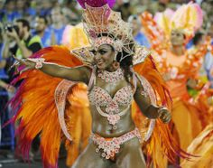 A reveller from the Vila Isabel samba school participates in the annual Carnival parade in Rio de Janeiro's Sambadrome, March 4, 2014. REUTERS/Sergio Moraes (BRAZIL - Tags: ENTERTAINMENT SOCIETY)...