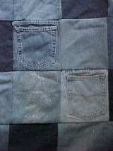 Jean quilt out of pockets and legs of old jeans. Cute idea.
