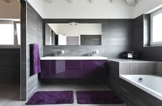 Purple and Grey classy bathroom color scheme, purple cabinets,Grey wall tiles and purple rug in a modern bathroom