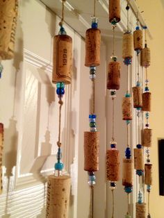Wine cork curtain:   drill corks, add beads and corks to  jute cord.  Tie knots to secure.  Purchase a 36 inch dowel and drill holes in dowel.  Tie knots to secure to rod.  I used eye hooks to attach to the door frame on small nails.