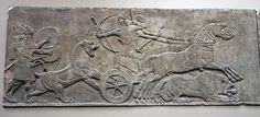 Assyrian lion hunting relief from Nineveh.  Photo taken by Ealdgyth at the British Museum, London:    Lion hunt. Assyrian, about 865-860 BC. From Nimrud, North-West Palace, Room B, panel 19 (top). King Ashurnasirpal shoots at a wounded lion.