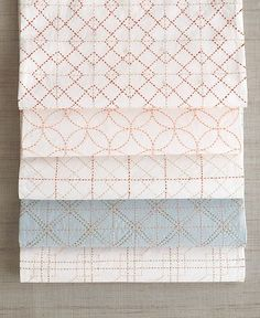 japanese sashiko embroidery. The patterns shown here from top to bottom: hiyokuigeta shippoutsunagi hiyokuigeta koushiawase and koushitsunagi.