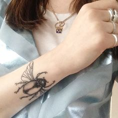 "Lara Carter, Starworks PR Junior Account Manager""My latest one is still healing. It's a scarab beetle. I love that in ancient Egypt, jewelled funerary scarabs represented the heart on mummified bodies. As with my other tattoos, this was done at Shangri-la."""