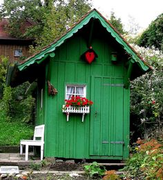 green house -love the asymmetrical roofline, barn door, gingerbread, tiny window & box planter, pops of red.  cute, cute!