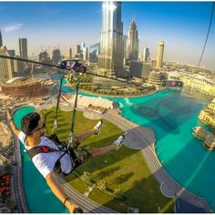 Flying on a zip wire over the fountains of the Burj Khalifa, Dubai