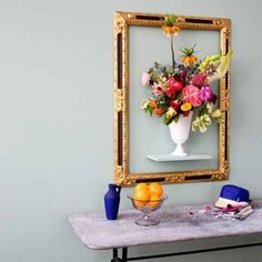 """Cool frame instillation idea alert! Take an ornate, empty frame and hang it around a floating shelf... This offers an opportunity to """"frame"""" almost anything :-) Like this """"live"""" floral still life, a unique piece of pottery or a sculpture - maybe even a piece of framed art sitting inside the empty frame on the shelf. An empty frame + floating shelf instillation will not only add a sense of whimsy, it will also offer artful functionality!"""