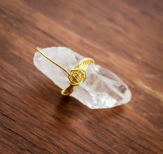 Hey, I found this really awesome Etsy listing at https://www.etsy.com/listing/187768568/gold-wire-wrapped-clear-quartz-pendant
