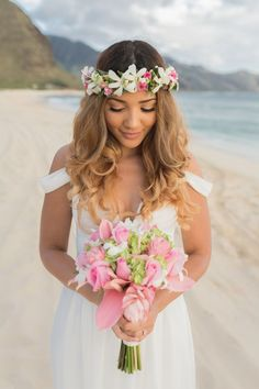 The most beautiful beach wedding hairstyles: updos, boho hairstyles, flowers, and more for short, medium and long hair.