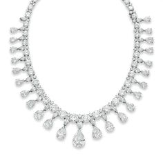 The Vanderbuilt Diamond Necklace. The front suspending a graduated fringe of detachable pear-shaped diamonds, each from an inverted pear-shaped diamond link, to a graduated line of circular-cut diamonds, spaced by smaller circular-cut diamonds, mounted in platinum, may be worn as 15½ or 13 ins.