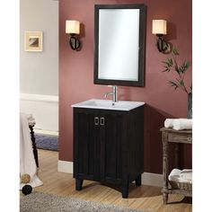 This single sink vanity will update the style of any bathroom. It features a ceramic sink-top and double door design with fashionable drop handles. A matching beveled edged framed wall mirror is also included to complete the look.