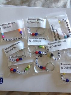 My handmade geoswag.  Keychains and bracelets with geocaching related words and…
