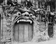 Entrance to the Cabaret L'Enfer, by Atget.  A Hell-themed café in Paris' red light district in the late 1800s.