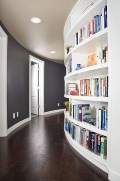 always love the idea of bookshelves along corridors and walkways connecting different rooms or parts of the house    @ leola490