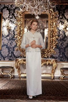 Princess Grace in the blue lounge in the Palais Princier de Monaco, wearing an evening dress designed by Guy Laroche, 1963.