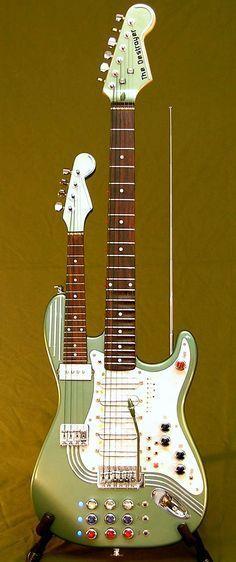 Mark Dalzell - The Destroyer Not only is it a 5(!) pickup electric Guitar with a scalloped fretboard and an electric Ukulele / 4 string Mandolin BUT there is a Theremin too ???AND !!!! --- https://www.pinterest.com/lardyfatboy/ Siga o nosso blog Mundo de Músicas em http://mundodemusicas.com/aulas-de-musica/  - Aprenda a tocar Guitarra como um profissional num dos Cursos desta página em http://mundodemusicas.com/aulas-de-musica/