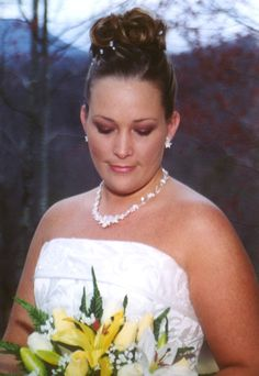 Our staff accentuates the natural beauty of our brides. We are conveniently located only minutes from the majority of Gatlinburg chapels.