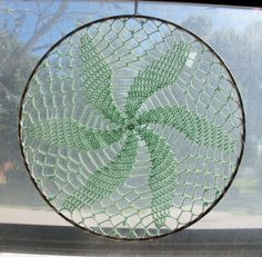 Whirlwind Suncatcher - Fine Crochet Doily in Metal Hoop for Hanging. $13,00, via Etsy.
