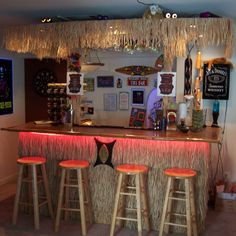 tiki bar - don't really like the bar but wanted to remember the look of rope lights underneath, nice touch.