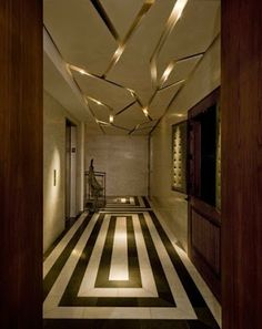 Great geometric floor pattern & gold ceiling. Great Interior Designs We Love at Design Connection, inc. | Kansas City Interior Design #GoldCeiling #GeometricFloor #InteriorDesign http://www.DesignConnectionInc.com/Blog