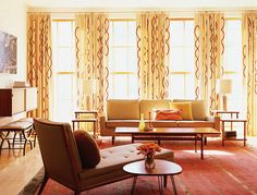 Decor with crisp, clean lines and the patterned drapes give the room a midcentury modern vibe