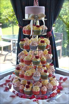Love the colors and the cake at the top.  I really want one of these acrylic cupcake stands!