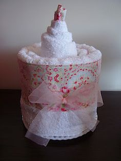 A pamper birthday cake, with towel and wash cloth trimmed in Cath Kidston fabric....A great housewarming, wedding shower or mother's day gift (maybe tuck some nice things in the folds?)