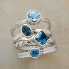 Four cuts of topaz, four styles of sterling silver band…to nestle together or wear singly. Handmade with London, Swiss and sky blue topaz gems. Set of 4. Whole sizes 5 to 9.