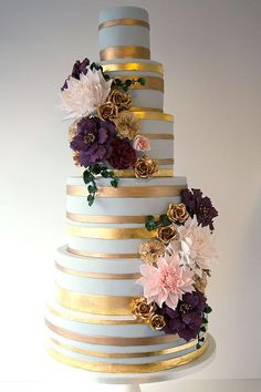 Wildflower Cakes London Oplulent wedding cake with gold leaf bands and autumal sugar flowers, dahlias, roses, ivy and maybe some David Austin Roses added?