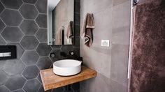 Kyle & Kara's bathroom The Block. Hexagonal feature tiles & large format grey tiles.
