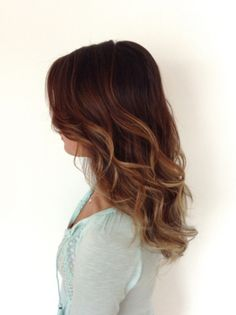 Long healthy brown hair. Balayage gives the hair dimension and texture. Soft loose sexy waves.