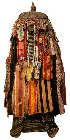"Yoruba Egungun Costume 13.Egungun, or ""powers concealed,"" refers both to the nature of the masked dance and to the spiritual power of the ancestors it honors. Over time an egungun mask is built up with layer upon layer of local and imported cloth. Its many panels celebrate the wealth and status of all family members, living or dead. During a performance individual cloth strips fan out in every direction but the dancer's body is never revealed. (per Smithsonian National Museum of African Art)"