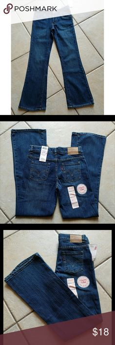"""NWT Levi's 517 Flare Stretch Jeans Sz.14 adj waist New With Tags Levi's 517 Flare Stretch Girls Jeans Color is Dark Eagle Blue Size 14 Regular has adjustable waist Measurements waist laid flat is 14.5"""" Inseam 29"""" Length 37"""". Comes from CLEAN and Smoke Free Home Levi's Bottoms Jeans"""