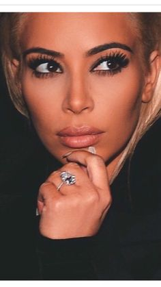 Kim Kardashian West blonde hair March 2015. Can we all just take a minute and admire her amazing eyebrows and eyelashes?