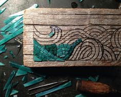 Driftwood, stained glass tiles, and wood burning