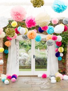 welcome people outside to the garden through this archway of pom pom tissues!