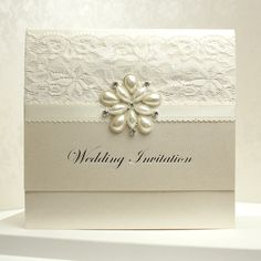 http://www.eliteinvite.com/weddings/wedding-invitations/pocket-invitations/pocket-style-invite-with-a-large-pearl-star-shaped-broach-and-lace.html