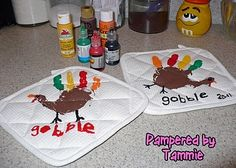 Turkey Potholders!  SUPPLIES: paint & white/light colored potholders ::: Get creative with your Little for Thanksgiving.  Use their own hands to make a holiday keepsake.